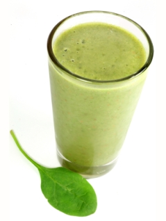 A healthy drink containing fruit and vegetable juices as well as spinach.